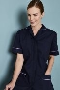 FM1450   Essentials Women's Classic Collar Healthcare Tunic, Navy with Lilac Trim